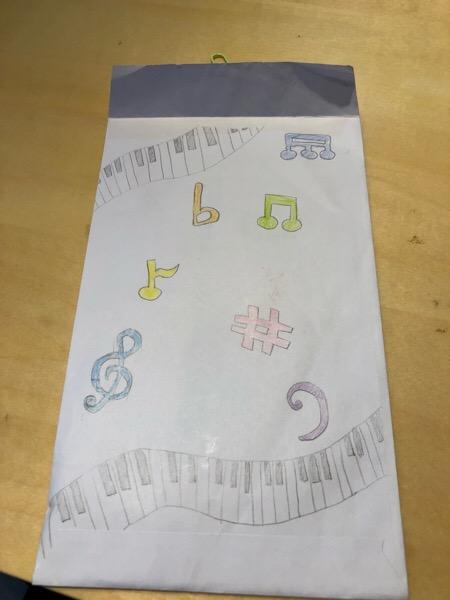月謝袋に絵を描いてくれました